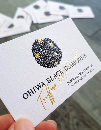 Embossed truffle design + gold foil on thick white card for business cards