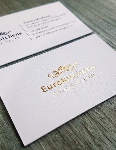 Eurokitchens Design business cards, gold foil stamped logo on a luxury textured white stock