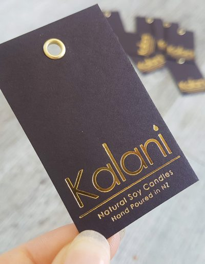 Swing tags with gold eyelets