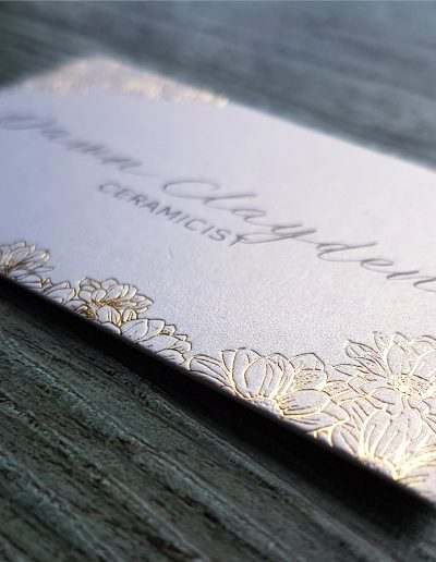 Gold detailing on metallic white cards