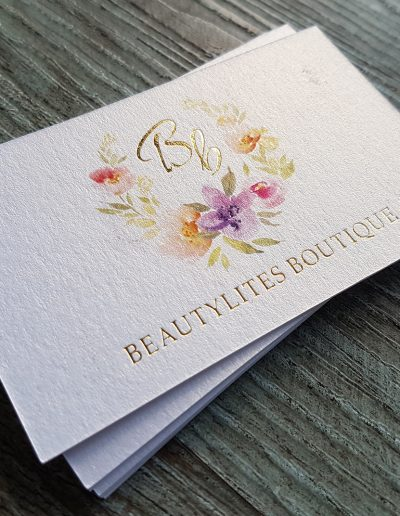 Beautiful floral design printed on metallic white card