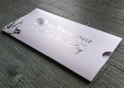 Gift voucher presentation sleeve, silver foil on metallic white