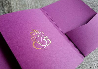 Ganesha, gold foil stamped design onto purple pocketfold envelopes