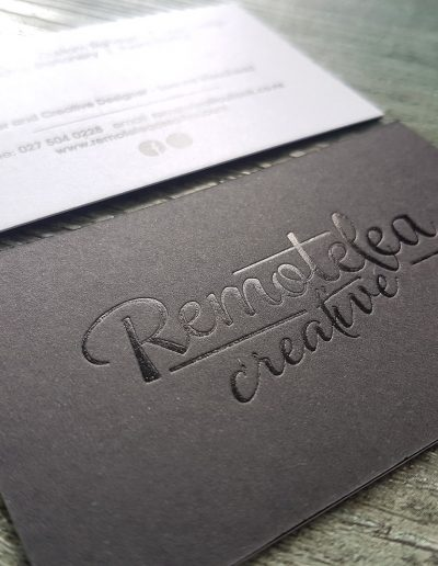 Gloss black foil pressed into a thick black card sandwiched with white card
