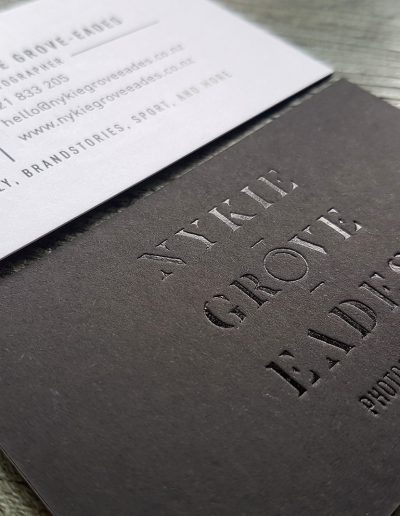 Gloss black foil on black card sandwiched with white for an ultra thick business card