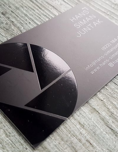 Printed black on white card, matt laminated and foiled