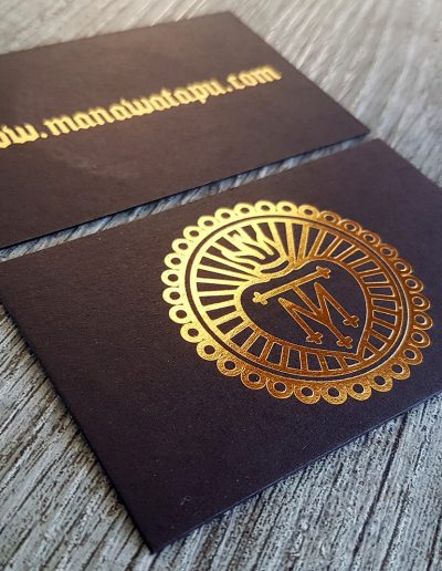 Gold foil stamped logo on ultra thick black cards