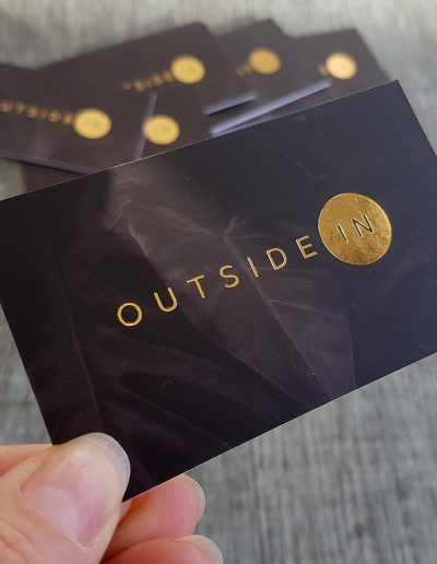 Gold foil stamped logo pressed onto thick business cards for Outside In, Custom Designed Greenery