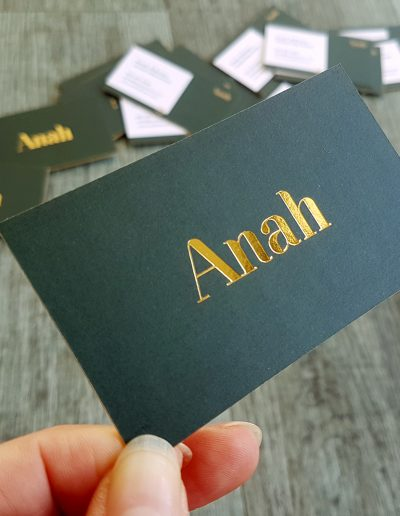 Forest green and gold business cards printed on a smooth card finish