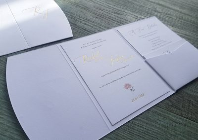 Gold and white pocketfold invitation set