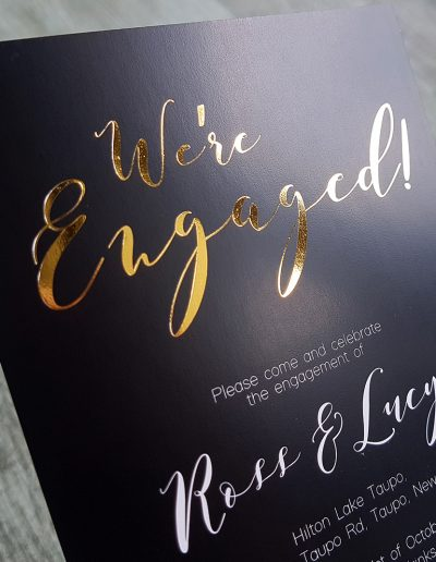 Gold and black engagement invitations