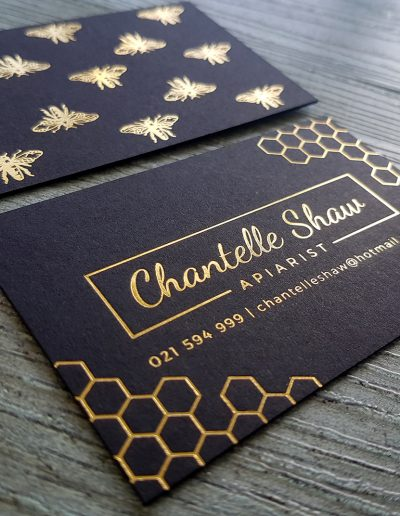Gold foil stamped cards with honeycomb + bee imagery designed and printed by Pinc