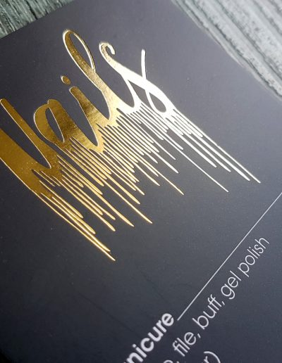 Gold NAILS logo designed by Pinc, printed here on service menus