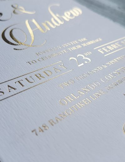 Gold foil stamp on textured white card