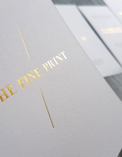 Gold foil detail cards pressed into a textured white card stock