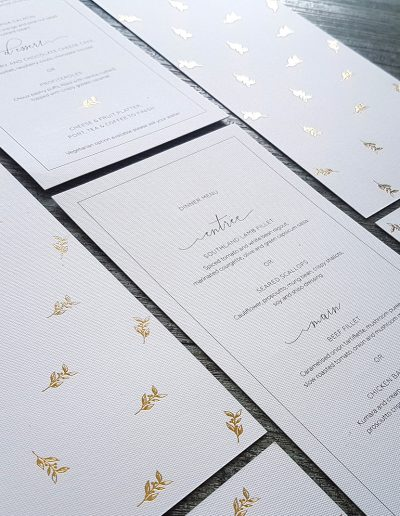 Gold foil stamped wedding menus + colour printing on thick textured white card