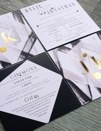 Gold foil initials on NZ wedding invitation design
