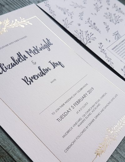 Pretty floral wedding invitation design with gold and ivory tones