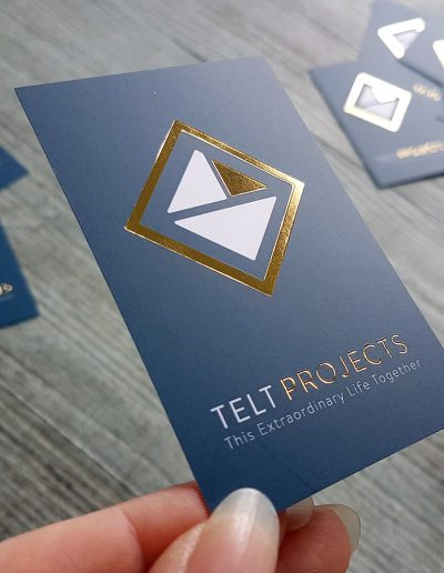 Gold foil stamped logo printed onto business cards for TELT Projects