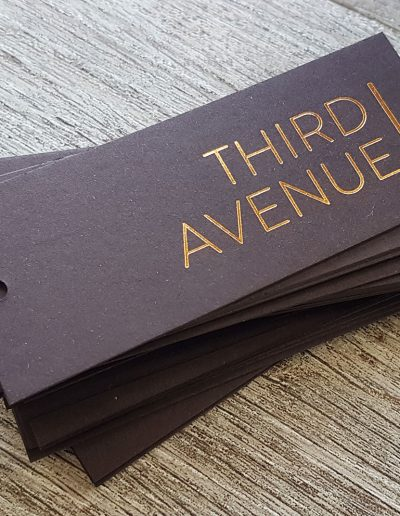 Gold foil stamped swing tags for Third Avenue