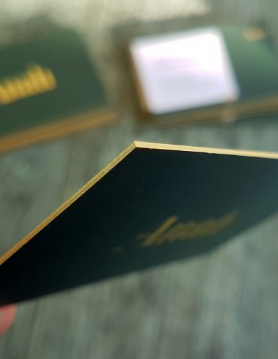 Gold sides on these forest green and gold business cards