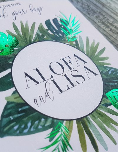 Green foil stamp on botanical themed Save the Date cards designed and printed by Pinc