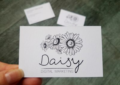 Digital printing for Daisy Digital, NZ marketing company, on a textured white stock