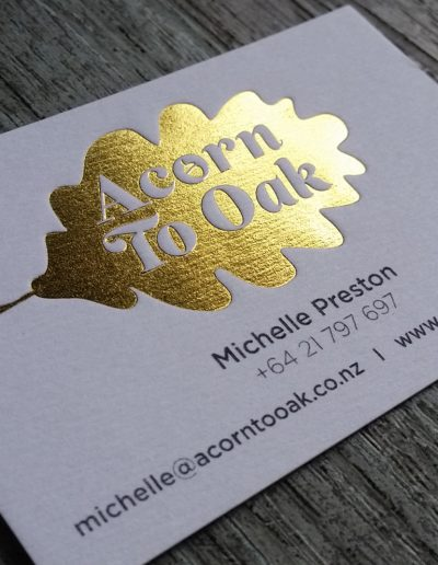 Lush gold foil stamp onto textured white
