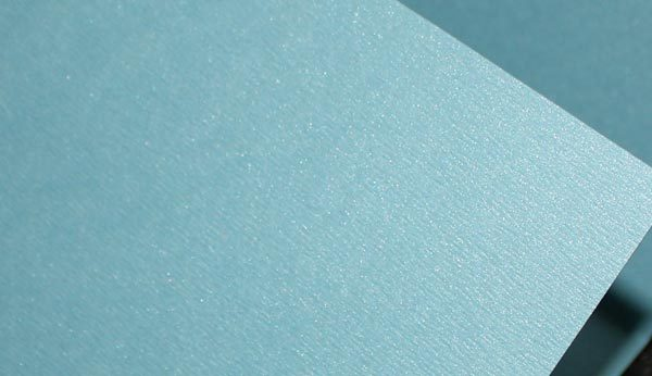 Light blue metallic card close up