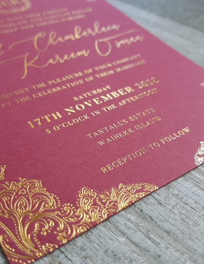 Close up of the intricate detail foil stamped in gold on wedding invitations designed and printed by Pinc