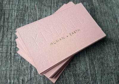 Debossing and gold foil on metallic rose gold business cards
