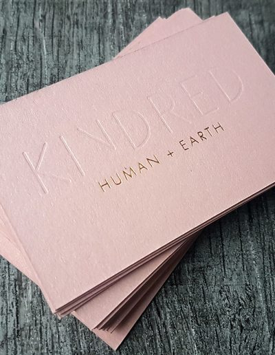Indented, debossed logo on Kindred cards