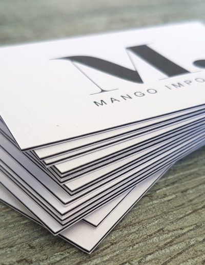 Layered business cards with black seam