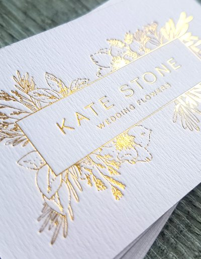 Beautifully indented gold foil logo pressed into thick textured white card