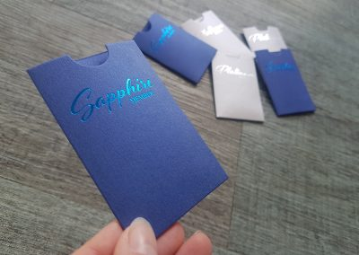 Custom metallic blue sleeves with blue foil stamp