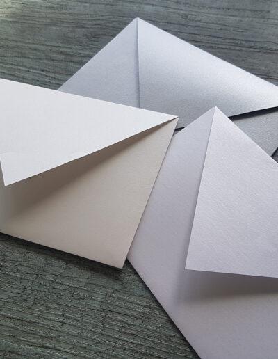metallic envelopes in silver, white and quartz