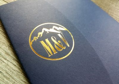 Gold monogram on navy pocketfold