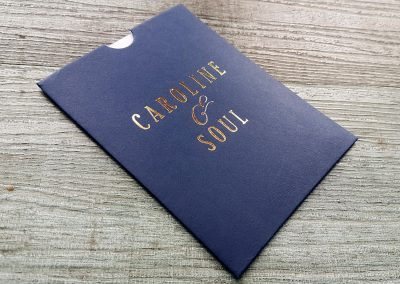 Navy invitations sleeves personalised with gold foil names