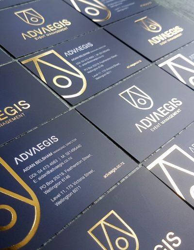 Double sided gold foil stamps on navy print with matt laminate coating