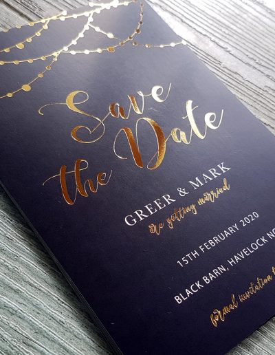 Gold and navy Save The Date cards