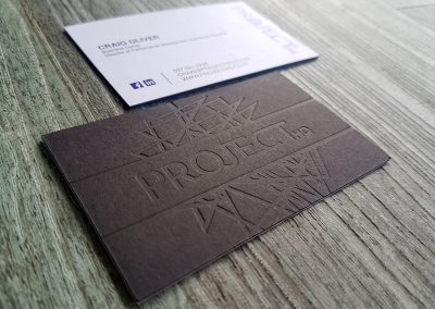 Blind debossed business cards on an ultra thick black and white sandwich