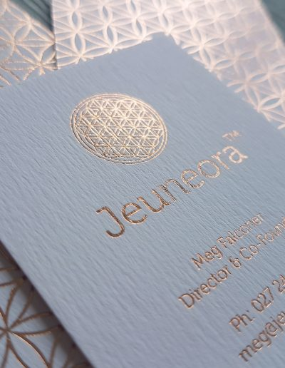 Rose gold foil on textured white business cards for a premium print finish