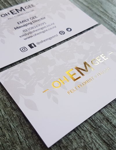 Gold foil business cards on a white silk card stock for NZ business Oh Em Gee