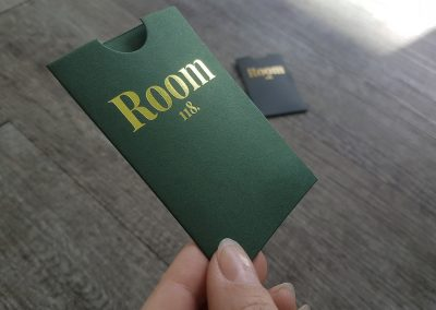 Gold foil on forest green business-card-sized sleeves