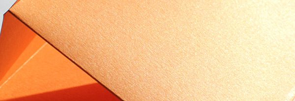 Orange metallic card close up