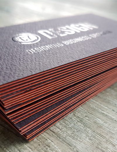 Black and orange sandwiched cards