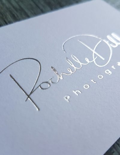 Silver foil stamped business card on thick, quality white card