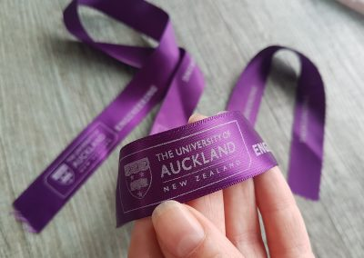 Purple and white branded ribbon