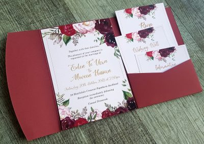 Burgundy pocketfold wedding invitation set with modern floral design