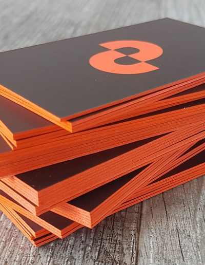 Business cards with bright orange edges